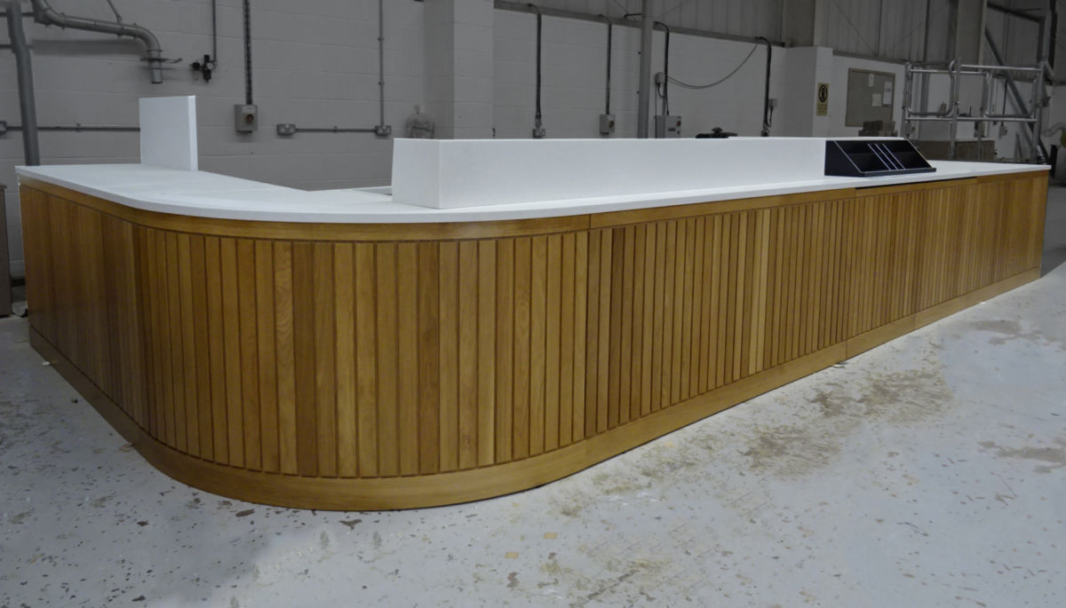 Slatted wood front with solid surface counter